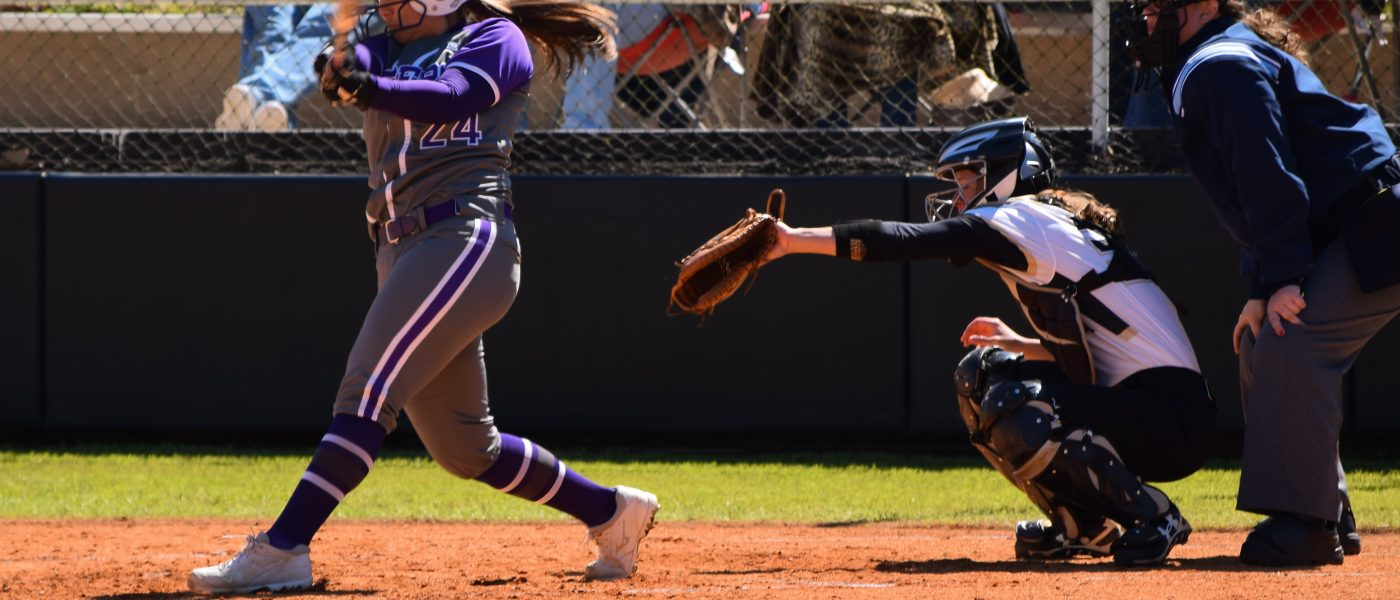 Softball splits series